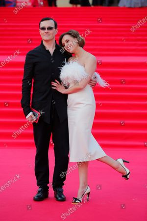 Russian actors Egor Beroev and Ksenia Alferova arrive at the opening ceremony of the 43rd Moscow International Film Festival in Moscow, Russia, on