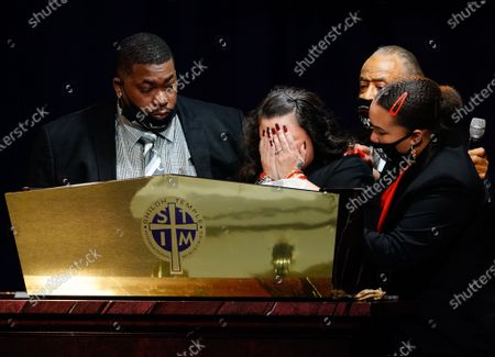 Aubrey Wright and the Reverend Al Sharpton and a family member comfort Katie Wright as she delivers remarks during the funeral for 20 year old Daunte Wright who was shot and killed by police officer Kimberly Ann Potter during a traffic stop and attempted arrest in Brooklyn Center