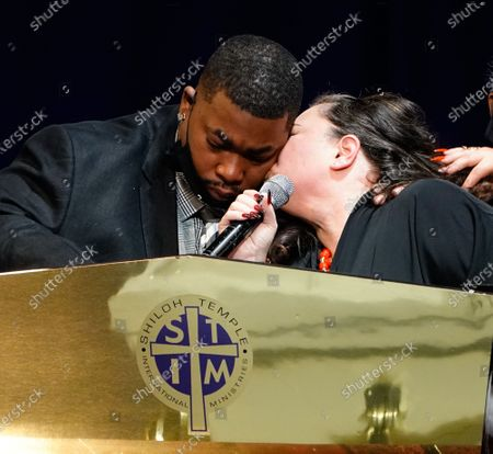 Aubrey Wright receives a kiss from his wife Katie Wright as they deliver remarks during the funeral for their son Daunte Wright at Shiloh Temple in Minneapolis on Thursday, April 22, 2021. Twenty-year-old Daunte Wright was shot and killed by police officer Kimberly Ann Potter during a traffic stop and attempted arrest in Brooklyn Center, Minnesota