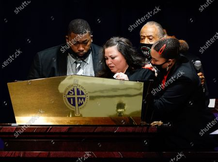 Aubrey Wright and Katie Wright are joined on stage by the Reverend Al Sharpton and a family member as they deliver remarks during the funeral for 20 year old Daunte Wright who was shot and killed by police officer Kimberly Ann Potter during a traffic stop and attempted arrest in Brooklyn Center