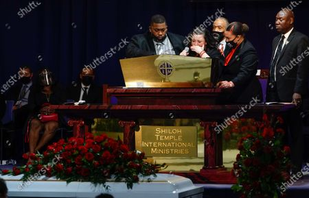 Aubrey Wright, the Reverend Al Sharpton, Benjamin Crump  and a family member join Katie Wright onstage as she delivers remarks during the funeral for 20 year old Daunte Wright who was shot and killed by police officer Kimberly Ann Potter during a traffic stop and attempted arrest in Brooklyn Center