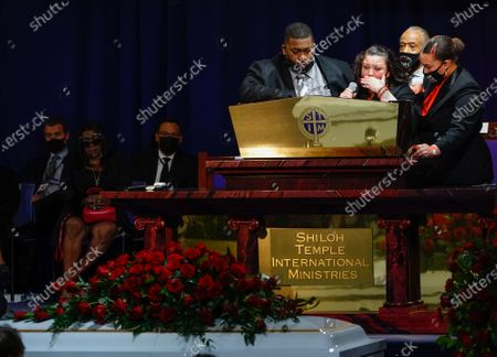 Stock Picture of Aubrey Wright, the Reverend Al Sharpton and a family member join Katie Wright onstage as she delivers remarks during the funeral for 20 year old Daunte Wright who was shot and killed by police officer Kimberly Ann Potter during a traffic stop and attempted arrest in Brooklyn Center