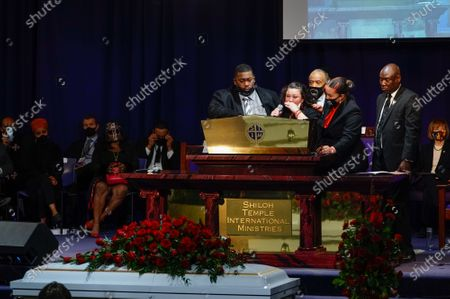 Stock Image of Aubrey Wright, the Reverend Al Sharpton, Benjamin Crump  and a family member join Katie Wright onstage as she delivers remarks during the funeral for 20 year old Daunte Wright who was shot and killed by police officer Kimberly Ann Potter during a traffic stop and attempted arrest in Brooklyn Center