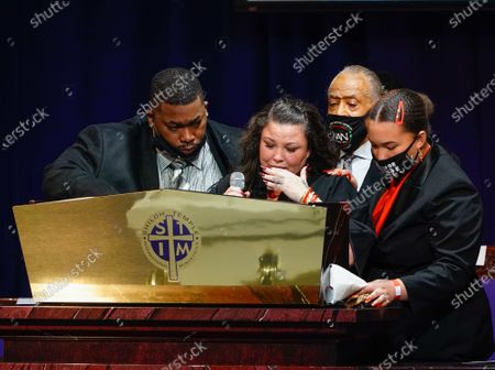 Aubrey Wright, the Reverend Al Sharpton and a family member join Katie Wright onstage as she delivers remarks during the funeral for 20 year old Daunte Wright who was shot and killed by police officer Kimberly Ann Potter during a traffic stop and attempted arrest in Brooklyn Center