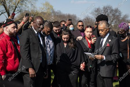 Reverend Al Sharpton reads a prayer with Daunte Wright's family before releasing doves in his honor during Daunte's burial at Lakewood Cemetery
