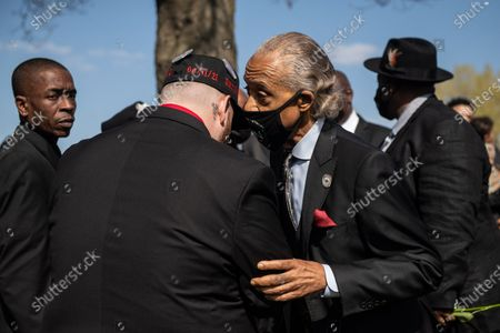 Reverend Al Sharpton shares a moment with Daunte Wright's brother, Damik Wright during Daunte's burial at Lakewood Cemetery