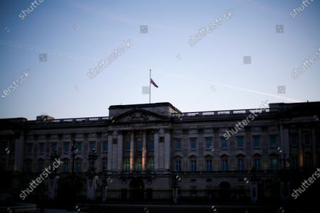 Stock Photo of A Union flag flies at half-mast from the roof of Buckingham Palace, as the Royal Family continues to mourn the death of Prince Philip, in London, England, on April 22, 2021.