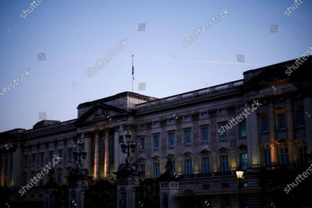 Stock Image of A Union flag hangs at half-mast from the roof of Buckingham Palace, as the Royal Family continues to mourn the death of Prince Philip, in London, England, on April 22, 2021.