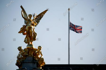 Stock Picture of A Union flag flies at half-mast from the roof of Buckingham Palace, as the Royal Family continues to mourn the death of Prince Philip, in London, England, on April 22, 2021.