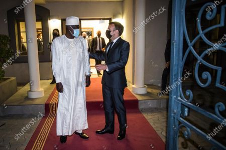 French President Emmanuel Macron (R) greets Chairman of the African Union Commission Moussa Faki Mahamat (L) after a meeting with African leaders of the Sahel countries as part of the funerals of Chad President Deby in N'Djamena, Chad, 22 April 2021. Chad's President Idriss Deby died of injuries suffered in clashes with rebels in the country's north, an army spokesperson announced on state television on 20 April 2021. Deby had been in power since 1990 and was re-elected for a sixth term in the 11 April 2021 elections.