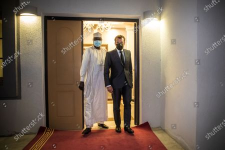 French President Emmanuel Macron (R) and Chairman of the African Union Commission Moussa Faki Mahamat (L) walk out after a meeting with African leaders of the Sahel countries as part of the funerals of Chad President Deby in N'Djamena, Chad, 22 April 2021. Chad's President Idriss Deby died of injuries suffered in clashes with rebels in the country's north, an army spokesperson announced on state television on 20 April 2021. Deby had been in power since 1990 and was re-elected for a sixth term in the 11 April 2021 elections.