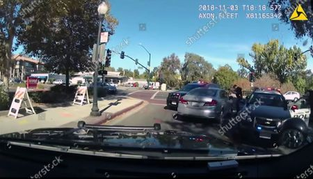 This image from body-worn camera video provided by the Contra Costa Sheriff shows Contra Costa County sheriff's Deputy Andrew Hall with his gun pointed into a car driven by Laudemar Arboleda, Nov. 3, 2018, in Danville, Calif. Hall has been charged in the fatal shooting of Arboleda, a Filipino man who was unarmed. Hall was charged with manslaughter and assault, after shooting Arboleda nine times during the slow-moving car pursuit