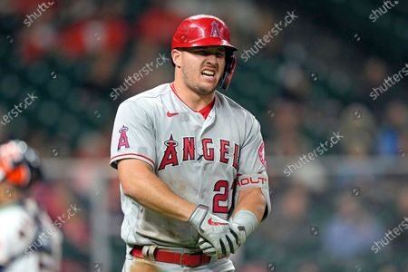 Los Angeles Angels' Mike Trout reacts after being hit by a pitch thrown by Houston Astros' Cristian Javierp during the fourth inning of a baseball game, in Houston