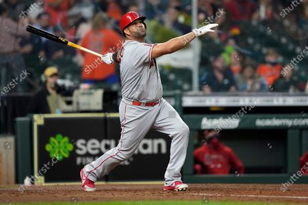 Stock Photo of Los Angeles Angels' Albert Pujols hits a two-run home run against the Houston Astros during the sixth inning of a baseball game, in Houston