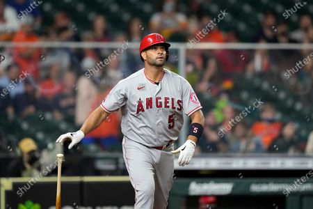 Stock Image of Los Angeles Angels' Albert Pujols watches his two-run home run against the Houston Astros during the sixth inning of a baseball game, in Houston