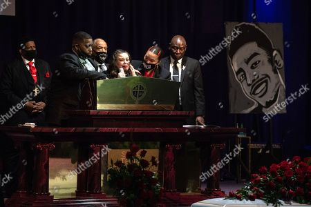 Reverend Al Sharpton, Daunte Wright's mother, Katie Wright speaks during his funeral inside the New Shiloh Temple alongside Attorney Benjamin Crump