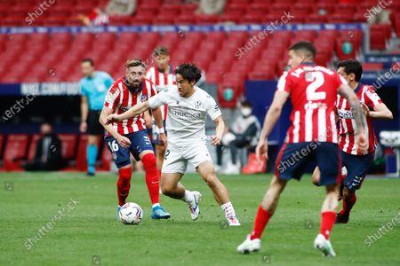 Stock Picture of Shinji Okazaki of Huesca and Hector Herrera of Atletico de Madrid