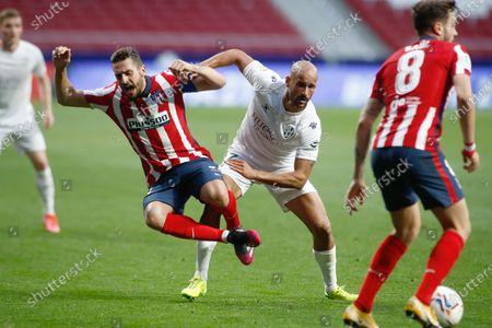 "Sandro Ramirez of Huesca and Jorge Resurreccion ""Koke"" of Atletico de Madrid"