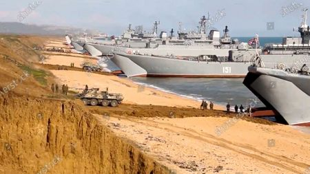 From a video released on by Russian Defense Ministry Press Service shows, Russian troops board landing vessels after drills in Crimea. Russian Defense Minister Sergei Shoigu on Thursday ordered troops back to their permanent bases after a massive military buildup that caused Ukrainian and Western concerns