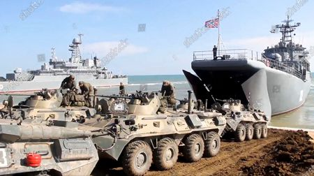 From a video released on by Russian Defense Ministry Press Service shows, Russian military's armored vehicles roll into landing vessels after drills in Crimea. Russian Defense Minister Sergei Shoigu on Thursday ordered troops back to their permanent bases after a massive military buildup that caused Ukrainian and Western concerns