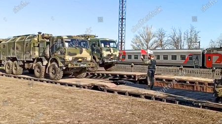 From a video released on by Russian Defense Ministry Press Service shows, Russian military trucks are readied for loading after drills in Crimea. Russian Defense Minister Sergei Shoigu on Thursday ordered troops back to their permanent bases after a massive military buildup that caused Ukrainian and Western concerns