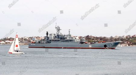 From a video released on by Russian Defense Ministry Press Service shows, A landing vessel of the Russian navy prepares to sail off to carry troops to their base after drills in Crimea. Russian Defense Minister Sergei Shoigu on Thursday ordered troops back to their permanent bases after a massive military buildup that caused Ukrainian and Western concerns