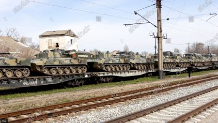 From a video released, by Russian Defense Ministry Press Service shows, Russian military vehicles stand on railway platforms to be carried back to their base after drills in Crimea. Russian Defense Minister Sergei Shoigu on Thursday ordered troops back to their permanent bases after a massive military buildup that caused Ukrainian and Western concerns