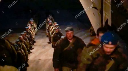 From a video released on by Russian Defense Ministry Press Service shows, Russian airborne troops get on a plane after drills in Crimea. Russian Defense Minister Sergei Shoigu on Thursday ordered troops back to their permanent bases after a massive military buildup that caused Ukrainian and Western concerns