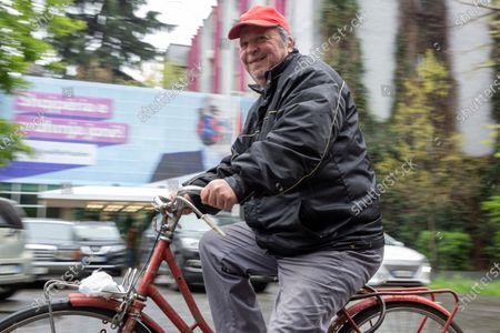Cyclist passes by a electoral poster of Socialist leader Edi Rama in Albania's capital Tirana on . Albania holds parliamentary elections on Sunday amid the virus pandemic and a bitter political rivalry between the country's two largest political parties but that will serve as a key milestone in the country's next step toward European Union membership