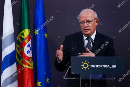 Portuguese Foreign Minister Augusto Santos Silva and the President of European Investment Bank (EIB) Werner Hoyer (not pictured) attend a press conference after the European Union-Africa High-Level Green Investment Forum, a joint organization of the Portuguese Presidency of the Council of the European Union (EU) and the European Investment Bank (EIB), under the theme 'The Green Future of Africa: New investment paths for sustainable and inclusive development', after a month of dialogue between African and European countries on green transition and investment, in which 25 virtual conferences (Green Talks) were held in various capitals of the two continents, under the Portuguese Presidency of the Council of the EU, in Lisbon, Portugal, 23 April 2021. The forum brings together representatives from government and business, international finance and development institutions, civil society, and academia, bringing together different perspectives on sustainable development and green investment. An opportunity to share experiences and innovative approaches to mobilize private and public capital for the green transition in Africa and Europe, demonstrating how a green and sustainable business model can be profitable, create jobs and wealth, contributing to achieving global climate goals.