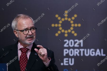 Stock Image of President of European Investment Bank (EIB) Werner Hoyer and Portuguese Foreign Minister Augusto Santos Silva (not pictured) attend a press conference after the European Union-Africa High-Level Green Investment Forum, a joint organization of the Portuguese Presidency of the Council of the European Union (EU) and the European Investment Bank (EIB), under the theme 'The Green Future of Africa: New investment paths for sustainable and inclusive development', after a month of dialogue between African and European countries on green transition and investment, in which 25 virtual conferences (Green Talks) were held in various capitals of the two continents, under the Portuguese Presidency of the Council of the EU, in Lisbon, Portugal, 23 April 2021. The forum brings together representatives from government and business, international finance and development institutions, civil society, and academia, bringing together different perspectives on sustainable development and green investment. An opportunity to share experiences and innovative approaches to mobilize private and public capital for the green transition in Africa and Europe, demonstrating how a green and sustainable business model can be profitable, create jobs and wealth, contributing to achieving global climate goals.