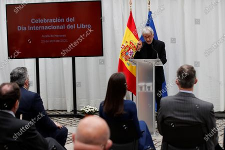 Spanish King Felipe VI (R, back to camera) and Queen Letizia of Spain (C, back to camera) listen to Spanish actor Jose Sacristan (C, rear) who reads texts of Spanish writers Miguel Delibes and Antonio Machado during an event held on occasion of International Book Day at Cervantes Institute in Madrid, 23 April 2021.