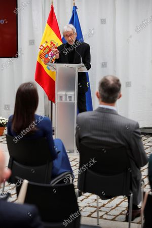 Spanish King Felipe VI (R, back to camera) and Queen Letizia of Spain (L, back to camera) listen to Spanish actor Jose Sacristan (C) who reads texts of Spanish writers Miguel Delibes and Antonio Machado during an event held on occasion of International Book Day at Cervantes Institute in Madrid, 23 April 2021.