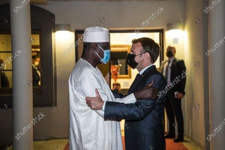 French President Emmanuel Macron (R) greets Chairman of the African Union Commission Moussa Faki Mahamat (L) after a meeting with African leaders of the Sahel countries as part of the funerals of Chad President Deby in N'Djamena, Chad, 22 April 2021. Chad's President Iriss Deby died of the wrong in clashes with rebels in the country's north, an spokesperson on state television on 20 April 2021. Deby has been in power since 1990 and was re-elected for a sixth term in the 11 April 2021 elections.