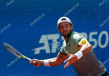 Matteo Berrettini of Italy returns a ball to Filip Krajinovic of Serbia during their tennis match of the Serbia Open tennis tournament in Belgrade, Serbia