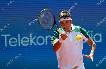 Filip Krajinovic of Serbia returns a ball to Matteo Berrettini of Italy during their tennis match of the Serbia Open tennis tournament in Belgrade, Serbia