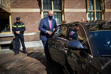 Dutch Outgoing Minister of Justice and Security (CDA) Ferdinand Grapperhaus (C) departs from the Binnenhof after a coronavirus meeting prior to the weekly Council of Ministers in the Hague, the Netherlands, 23 April 2021.