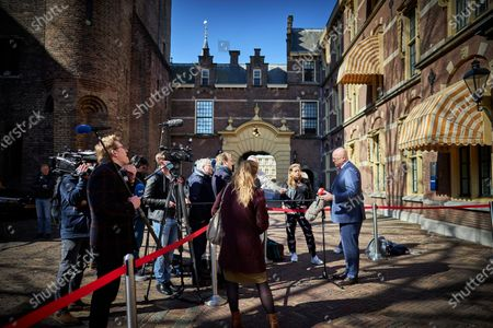 Stock Image of Dutch Outgoing Minister of Justice and Security (CDA) Ferdinand Grapperhaus (R) speaks to the press as he departs from the Binnenhof after a coronavirus meeting prior to the weekly Council of Ministers in the Hague, the Netherlands, 23 April 2021.