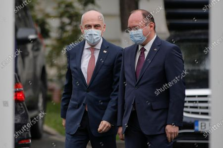 Georgian Foreign Minister David Zalkaliani, left, walks with Romanian counterpart Bogdan Aurescu in Bucharest, Romania, . Foreign ministers of Turkey, Romania and Poland met for an annual trilateral event that also included their counterparts from Ukraine and Georgia as participants discussed the tensions with Russia at Ukraine's borders