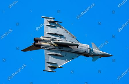Stock Image of Typhoon training  in the skies over RAF Scampton in Lincolnshire in preparation for this years airshows.Pilot Flt Lt James Sainty was seen putting the Typhoon through its paces off-site in the skies over RAF Scampton in Lincolnshire yesterday (Mon) Ð while the Red Arrows are abroad.The 2021 display pilot put in some off-site practise over Scampton, where the Red Arrows are normally based.Photographers Claire Hartley and Caroline Haycock took pictures of the Typhoon as the pilot practised for this yearÕs displays. The plane is based at RAF Coningsby and practice flights usually take place in that area.James was born in North Tyneside and grew up in Northumberland and joined 29 Squadron in 2019.