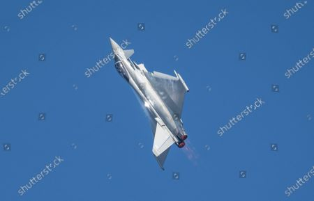 Stock Photo of Typhoon training  in the skies over RAF Scampton in Lincolnshire in preparation for this years airshows.Pilot Flt Lt James Sainty was seen putting the Typhoon through its paces off-site in the skies over RAF Scampton in Lincolnshire yesterday (Mon) Ð while the Red Arrows are abroad.The 2021 display pilot put in some off-site practise over Scampton, where the Red Arrows are normally based.Photographers Claire Hartley and Caroline Haycock took pictures of the Typhoon as the pilot practised for this yearÕs displays. The plane is based at RAF Coningsby and practice flights usually take place in that area.James was born in North Tyneside and grew up in Northumberland and joined 29 Squadron in 2019.