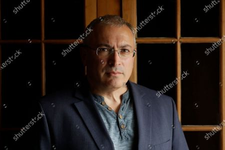 Russian opposition figure Mikhail Khodorkovsky, the former owner of the Yukos Oil Company, poses for a photograph after being interviewed by The Associated Press in London. A key legal advisor to the Dutch Supreme Court on Friday April 23, 2021, recommended dismissing Russia's appeal against a lower court's decision to reinstate a $50 billion compensation award to former shareholders of the Yukos oil company