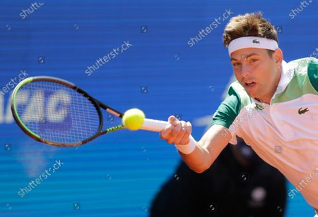 Stock Photo of Filip Krajinovic of Serbia in action against Matteo Berrettini of Italy during their quarter final match of the Serbia Open tennis tournament in Belgrade, Serbia, 23 April 2021.