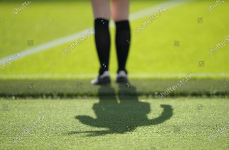 The shadow of lineswoman Sian Massey-Ellis