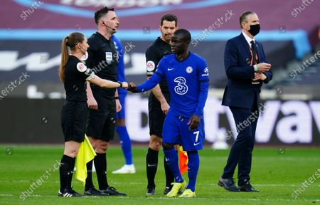 Ngolo Kante of Chelsea bumps fists with Assistant referee Sian Massey Ellis