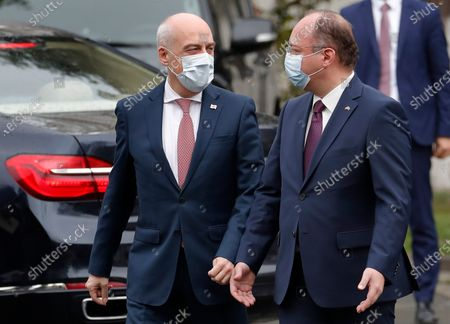 Stock Photo of Romanian Foreign Minister Bogdan Aurescu (R) and Georgia's Foreign Minister David Zalkaliani (L) chat as Zalkaliani arrives at Romanian Foreign Ministry Headquarters in Bucharest, Romania, 23 April 2021. Foreign ministers of Romania, Poland and Turkey met in Bucharest for the second working session of the Informal Trilateral Meeting on security issues, having as invitees their counterparts from Ukraine and Georgia.