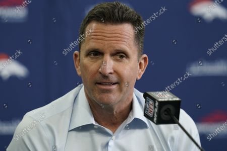 """Stock Image of Denver Broncos general manager George Paton speaks during a news conference at the NFL football team's headquarters in Englewood, Colo. Paton spent his first few months as John Elway's successor reconstructing the Broncos' gutted secondary and reinforcing Denver's overall defense. What he hasn't addressed is the franchise's biggest bugaboo - quarterback - after declaring last month """"we want to bring in competition"""" for Drew Lock, whose 15 interceptions in 13 games tied for the league lead in 2020"""