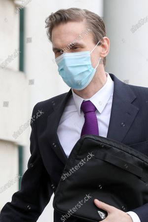 Dr Christian Jessen arrives at Belfast High Court today