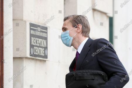 Dr Christian Jessen arrives at Belfast High Court today