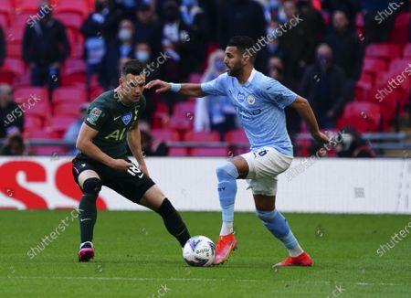 Riyad Mahrez of Manchester City and Giovani Lo Celso of Tottenham Hotspur